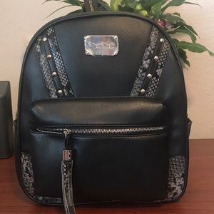 Bebe Jett stud snake backpack.